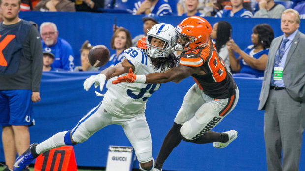 Aug 17, 2019; Indianapolis, IN, USA; Cleveland Browns wide receiver D.J. Montgomery (83) and Indianapolis Colts cornerback Marvell Tell (39) fight for a passed ball in the second half of the game at Lucas Oil Stadium.