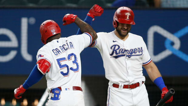 Jul 6, 2021; Arlington, Texas, USA; Texas Rangers center fielder Adolis Garcia (53) is congratulated by right fielder Joey Gallo (13) after hitting a home run in the eighth inning against the Detroit Tigers at Globe Life Field.