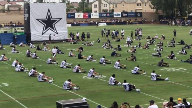 cowboys-stretching-at-camp