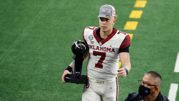 OU quarterback Spencer Rattler (7) walks off the field after beating Iowa State in the Big 12 title game last December. rattler