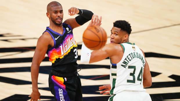 Phoenix Suns guard Chris Paul (3) passes the ball against Milwaukee Bucks forward Giannis Antetokounmpo