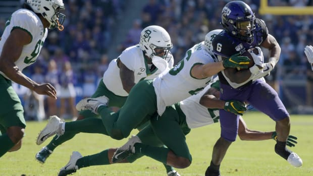 Nov 9, 2019; Fort Worth, TX, USA; TCU Horned Frogs running back Darius Anderson (6) carries the ball against the Baylor Bears in the first quarter at Amon G. Carter Stadium.