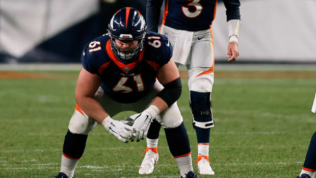 Denver Broncos quarterback Drew Lock (3) behind offensive guard Graham Glasgow (61) and center Lloyd Cushenberry III (79) in the fourth quarter against the Tennessee Titans at Empower Field at Mile High.