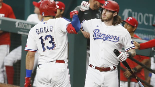 Jul 7, 2021; Arlington, Texas, USA; Texas Rangers right fielder Joey Gallo (13) is congratulated by catcher Jonah Heim (right) after hitting a home run in the second inning at Globe Life Field.