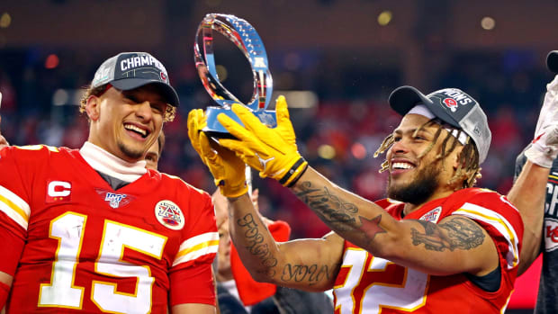 Jan 19, 2020; Kansas City, Missouri, USA; Kansas City Chiefs quarterback Patrick Mahomes (15) and strong safety Tyrann Mathieu (32) celebrate with the Lamar Hunt Trophy after beating the Tennessee Titans in the AFC Championship Game at Arrowhead Stadium. Mandatory Credit: Mark J. Rebilas-USA TODAY Sports
