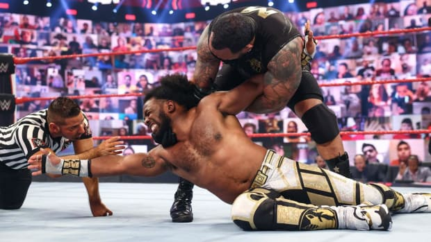 WWE's Kofi Kingston and MVP wrestle in the ring