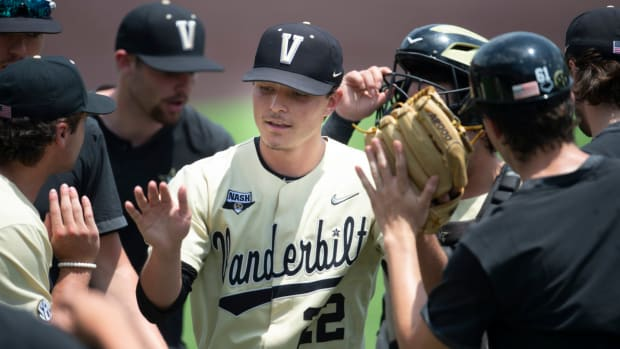 Vanderbilt pitcher Jack Leiter (22) is congratulated by teammates after pitching against East Carolina during the seventh inning of game 2 of the NCAA Super Regionals at Hawkins Field Saturday, June 12, 2021 in Nashville, Tenn.