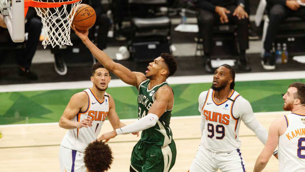 Milwaukee Bucks forward Giannis Antetokounmpo (34) shoots a layup during the second quarter against the Phoenix Suns during game three of the 2021 NBA Finals at Fiserv Forum.