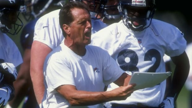 26 Jul 1998: Offensive line coach Alex Gibbs of the Denver Broncos discusses a play during the Broncos training camp at the University of Northern Colorado in Greeley, Colorado.