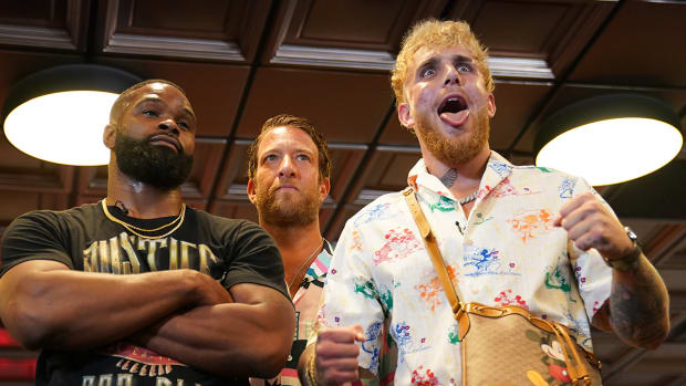 Tyron Woodley (left) and YouTube star Jake Paul (right) face off in front of Bar Stool Sports founder Dave Portnoy (middle).
