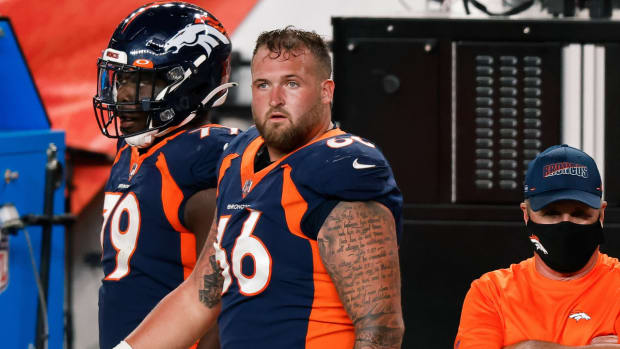Denver Broncos offensive guard Dalton Risner (66) and center Lloyd Cushenberry III (79) in the fourth quarter against the Tennessee Titans at Empower Field at Mile High.