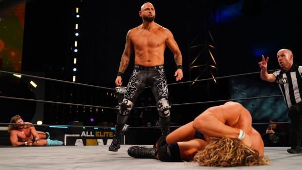 Karl Anderson stands over a fallen opponent on AEW Dynamite