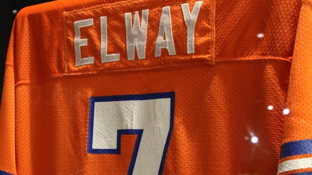 """A John Elway jersey is featured as part of the \""""Gridiron Glory\"""" exhibition at the Farmington Museum at Gateway Park."""