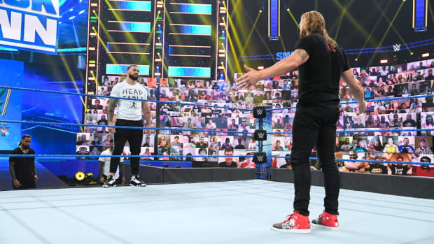 Edge and Roman Reigns stand across the ring on SmackDown