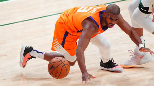 Phoenix Suns point guard Chris Paul turns the ball over.
