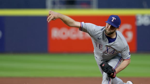 Jul 16, 2021; Buffalo, New York, USA; Texas Rangers starting pitcher Jordan Lyles (24) throws a pitch during the third inning against Toronto Blue Jays at Sahlen Field.