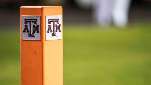 Texas A&M logo on a pylon.