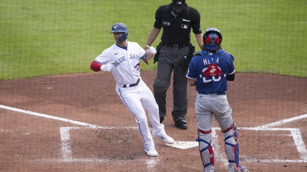 Jul 18, 2021; Buffalo, New York, CAN; Texas Rangers second baseman Nick Solak (15) touches home plate after hitting a two run home run during the second inning against the Texas Rangers at Sahlen Field.