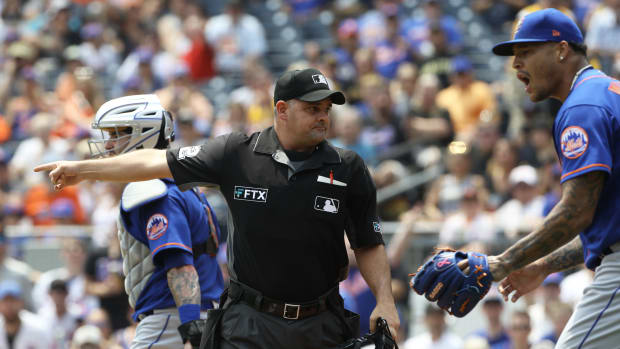 """Home plate umpire Jeremy Riggs points """"fair"""" after a Pirates hit."""