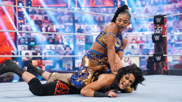 Bianca Belair locks Bayley in a submission hold