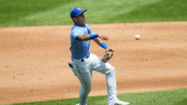 Jul 18, 2021; Kansas City, Missouri, USA; Kansas City Royals second baseman Nicky Lopez (8) throws to first base against the Baltimore Orioles during the second inning at Kauffman Stadium. Mandatory Credit: Jay Biggerstaff-USA TODAY Sports