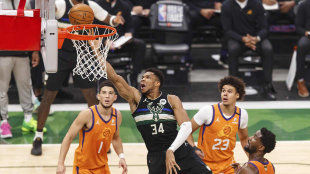 Jul 20, 2021; Milwaukee, Wisconsin, USA; Milwaukee Bucks forward Giannis Antetokounmpo (34) shoots during the first quarter against the Phoenix Suns during game six of the 2021 NBA Finals at Fiserv Forum. Mandatory Credit: Jeff Hanisch-USA TODAY Sports