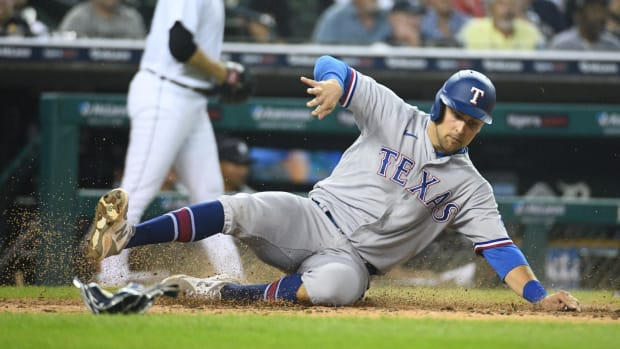 Jul 20, 2021; Detroit, Michigan, USA; Texas Rangers first baseman Nate Lowe (30) scores a run during the fifth inning against the Detroit Tigers at Comerica Park.