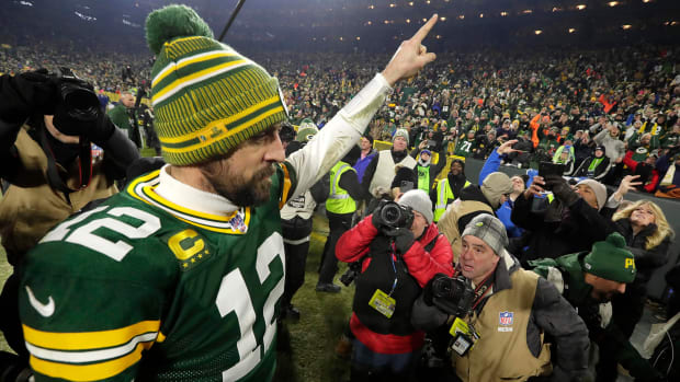 Aaron Rodgers points to the fans as he leaves Lambeau Field after a January 2020 playoff victory