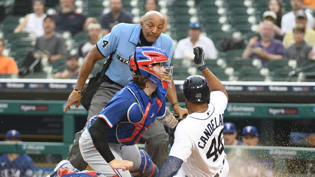 Jul 19, 2021; Detroit, Michigan, USA; Texas Rangers catcher Jonah Heim (28) tags out Detroit Tigers designated hitter Jeimer Candelario (46) at home during the fourth inning at Comerica Park.