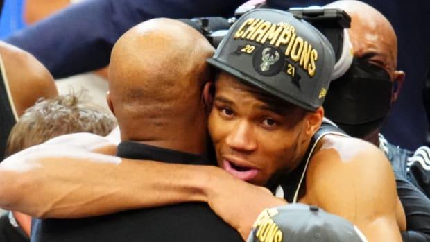 Giannis Antetokounmpo celebrates winning the NBA Finals