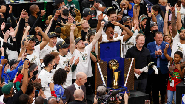 Milwaukee Bucks players celebrate after winning the NBA Championship following game six of the 2021 NBA Finals against the Phoenix Suns at Fiserv Forum.
