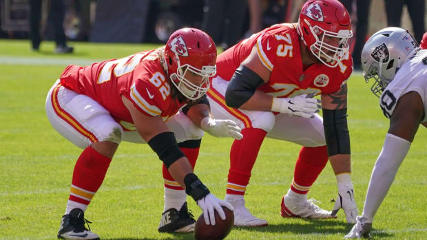 Oct 11, 2020; Kansas City, Missouri, USA; Kansas City Chiefs center Austin Reiter (62) prepares to snap the ball as offensive tackle Mike Remmers (75) readies to block during the game against the Las Vegas Raiders at Arrowhead Stadium. Mandatory Credit: Denny Medley-USA TODAY Sports