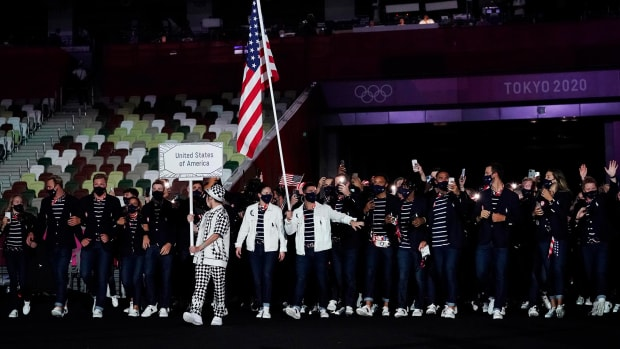 Jul 23, 2021; Tokyo, Japan; Team USA flag bearers Sue Bird and Eddy Alvares lead the team during the opening ceremony for the Tokyo 2020 Olympic Summer Games at Olympic Stadium.