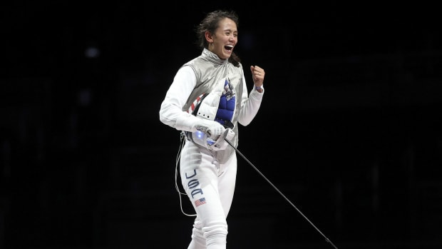 CHIBA, JAPAN – JULY 25, 2021: USA's Lee Kiefer celebrates winning her women's foil fencing individual gold medal bout against ROC's Inna Deriglazova during the Tokyo 2020 Summer Olympic Games, at the Makuhari Messe convention centre.