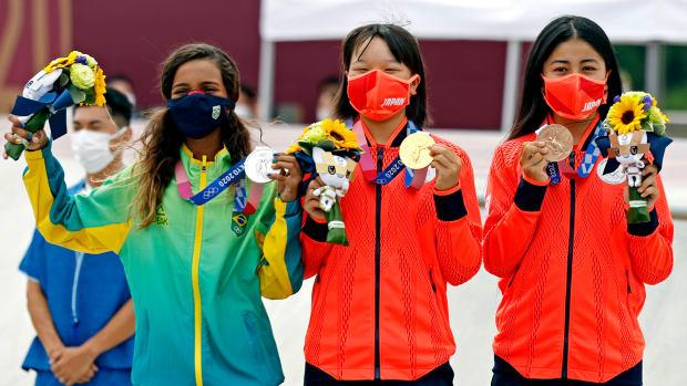 Rayssa Leal (BRA), silver, Momiji Nishiya (JPN), gold, and Funa Nakayama (JPN), bronze, celebrate with their medals in the womens street skateboard during the Tokyo 2020 Olympic Summer Games