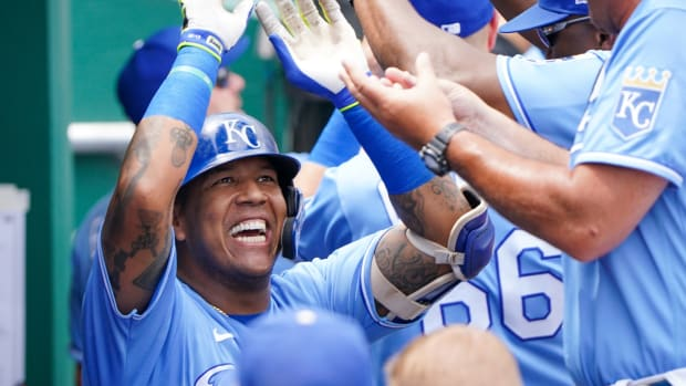 Jul 25, 2021; Kansas City, Missouri, USA; Kansas City Royals designated hitter Salvador Perez (13) is congratulated in the dugout after hitting a three run home run in the first inning against the Detroit Tigers at Kauffman Stadium. Mandatory Credit: Denny Medley-USA TODAY Sports