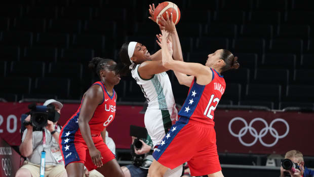 Diana Taurasi attempting to block a shot against Nigeria.