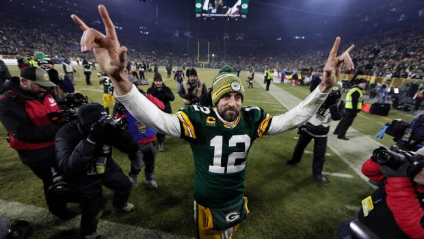 """Aaron Rodgers gives """"I love you"""" hand gesture to fans as he leaves the field after a playoff game in 2020"""