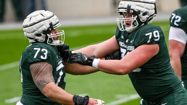 Michigan State's Jarrett Horst, right, battles with Jacob Isaia as part of a drill during the spring football game on Saturday, April 24, 2021, at Spartan Stadium in East Lansing.
