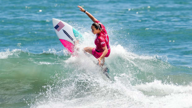 Carissa Moore surfing at the Olympics.