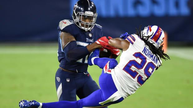 Tennessee Titans running back Derrick Henry (22) tosses Buffalo Bills cornerback Josh Norman (29) to the field during the second quarter at Nissan Stadium Tuesday, Oct. 13, 2020 in Nashville, Tenn.