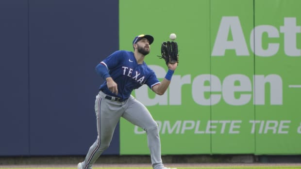 Jul 18, 2021; Buffalo, New York, CAN; Texas Rangers right fielder Joey Gallo (13) catches a fly ball hit by Toronto Blue Jays first baseman Vladimir Guerrero Jr. (27) (not pictured) during the fourth inning at Sahlen Field.
