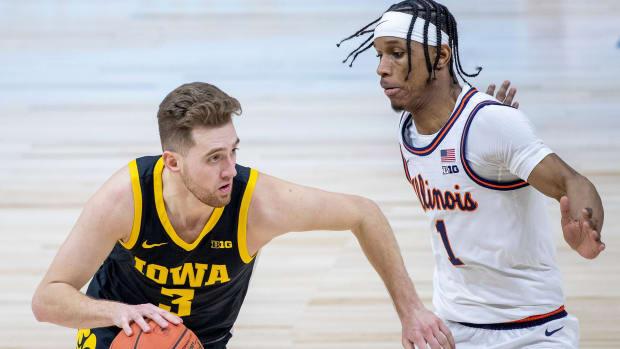 Iowa's Jordan Bohannon dribbles vs. Illinois's Trent Frazier