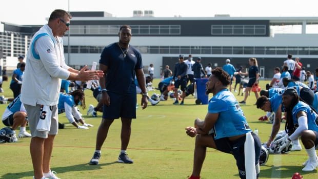 Tennessee Titans head coach Mike Vrabel talks with free safety Kevin Byard (31) as intern Christion Abercrombie listens in during a training camp practice at Saint Thomas Sports Park Wednesday, July 28, 2021 in Nashville, Tenn.