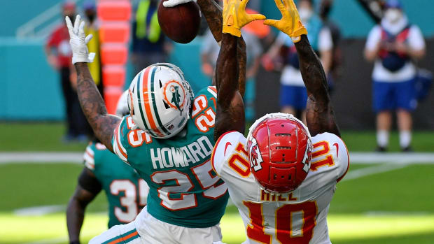 Dec 13, 2020; Miami Gardens, Florida, USA; Miami Dolphins cornerback Xavien Howard (25) makes a one handed catch to intercept a pass intended for Kansas City Chiefs wide receiver Tyreek Hill (10) during the second half at Hard Rock Stadium. Mandatory Credit: Jasen Vinlove-USA TODAY Sports