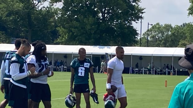 DeVonta Smith (left) and Jalen Hurts lave the field after first day of training camp, July 28, 2021