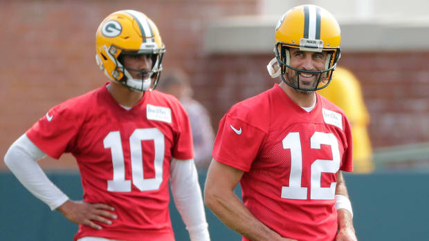Aaron Rodgers (12) and Jordan Love (10) at Packers training camp.