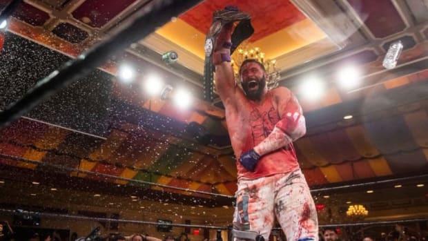 A bloody Matt Cardona celebrates after winning the GCW championship