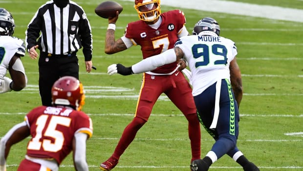 Dec 20, 2020; Landover, Maryland, USA; Washington Football Team quarterback Dwayne Haskins Jr. (7) attempts a pass as Seattle Seahawks defensive end Damontre' Moore (99) defends during the second half at FedExField. Mandatory Credit: Brad Mills-USA TODAY Sports