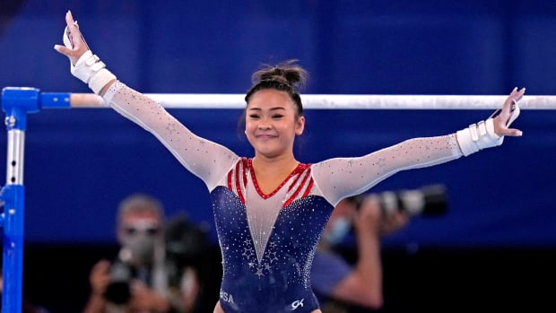 Suni Lee competing at the Olympics.